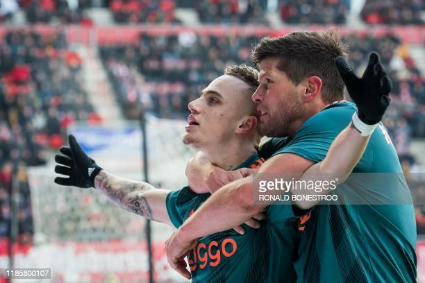 Ajax's Noa Lang celebrates with Ajax's KlaasJan Huntelaar after scoring a hat trick during the Dutch Eredivisie football match between FC Twente...