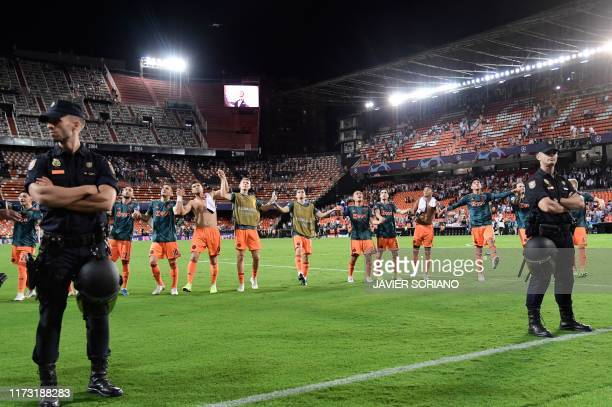 Ajax's players celebrate at the end of the UEFA Champions League Group H football match between Valencia and Ajax at the Mestalla stadium in Valencia...