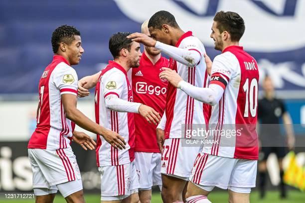 Ajax's players David Neres, Nicolas Tagliafico, Davy Klaassen, Sebastien Haller, and Dusan Tadic celebrate after scoring a goal during the Dutch...