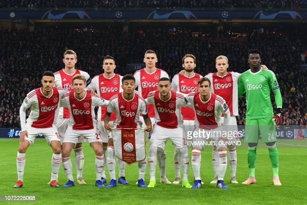 Ajax's players pose before the UEFA Champions League Group E football match between AFC Ajax and FC Bayern Munchen at the Johan Cruyff Arena in...