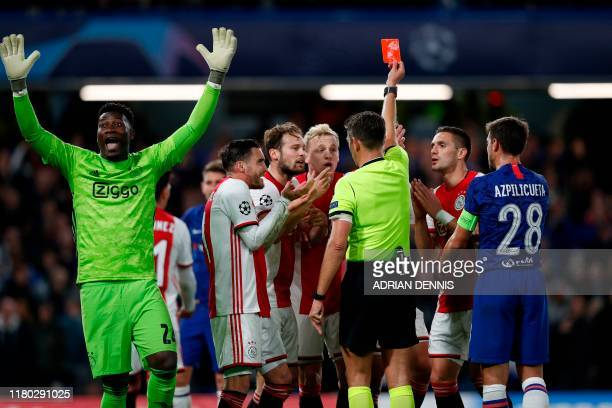 Ajax's players react after Ajax's Dutch defender Joel Veltman is shown a red card by Italian referee Gianluca Rocchi during the UEFA Champion's...