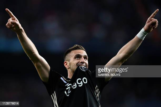 TOPSHOT Ajax's Serbian forward Dusan Tadic celebrates after scoring a goal during the UEFA Champions League round of 16 second leg football match...