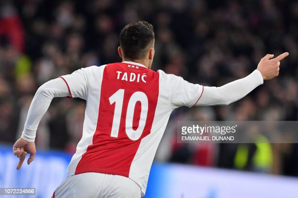 Ajax's Serbian forward Dusan Tadic celebrates after scoring during the UEFA Champions League Group E football match between AFC Ajax and FC Bayern...