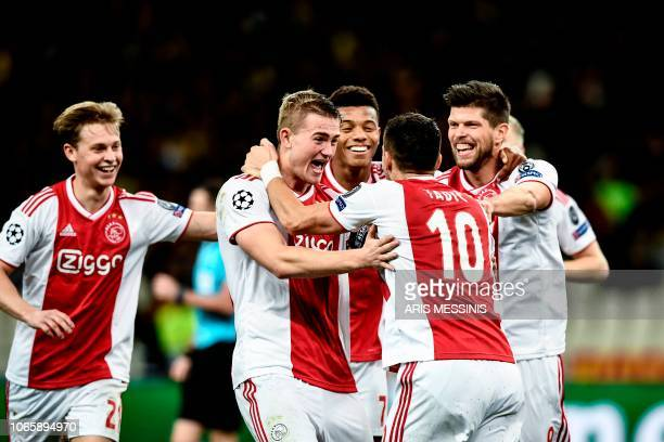 Ajax's Serbian forward Dusan Tadic celebrates with his teammates after scoring during the UEFA Champions League football match between AEK Athens FC...