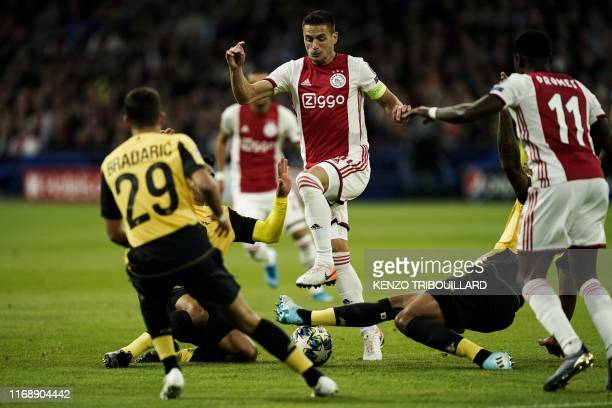 Ajax's Serbian forward Dusan Tadic controls the ball during the UEFA Champions league Group H football match between Ajax FC Amsterdam and LOSC Lille...