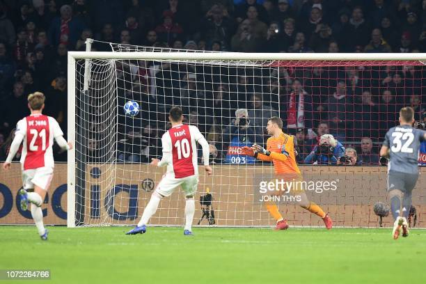 Ajax's Serbian forward Dusan Tadic kicks and scores their second goal on a penalty kick during the UEFA Champions League Group E football match...