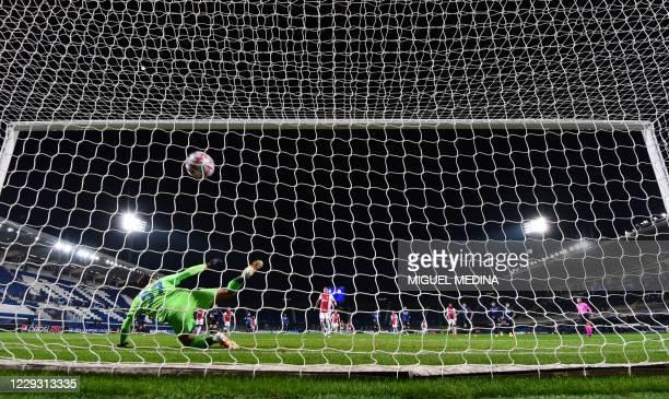 Ajax's Serbian forward Dusan Tadic scores a penalty kick past Atalanta's Italian goalkeeper Marco Sportiello during the UEFA Champions League group D...
