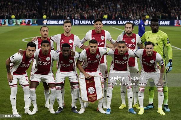 Ajax's team players Ajax'Argentinian defender Lisandro Martinez Ajax's Brazilian forward David Neres Ajax's Dutch forward Quincy Promes Ajax's...