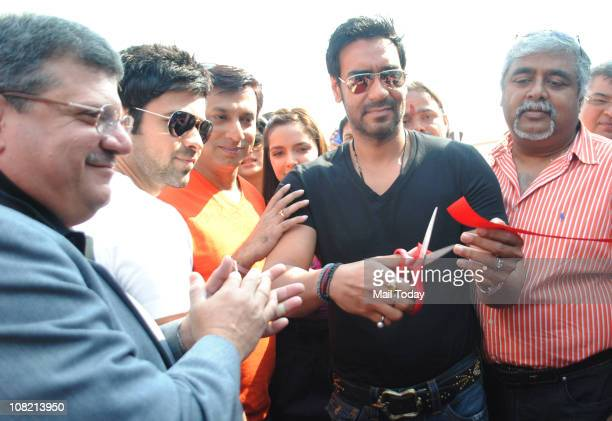 Ajay Devgan along with Cast of the movie Dil Toh Bacha Hai Jee at the inauguration of 'Mumbai International Motor' show at MMRDA Ground Mumbai on...