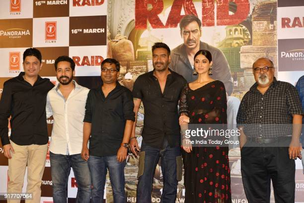 Ajay Devgan Ileana D'Cruz Bhushan Kumar and Saurabh Shukla during the trailer launch of the film Raid in Mumbai