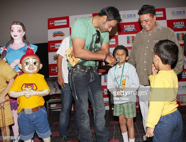 Ajay Devgan with kids at an event to promote his latest film Toonpur Ka Superhero in Mumbai