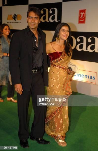 "Ajay Devgn and Kajol Devgn attend the film premiere of ""PAA"" on December 03, 2009 in Mumbai, India."