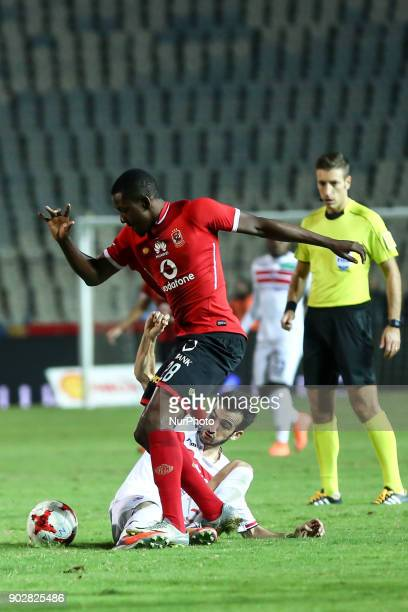 Ajay Jr of AlAhly in action against AlZamalek Mohamed Donga during the Egypt Premier League Fixtures 17 match between Al Ahly and Zamalek at the...