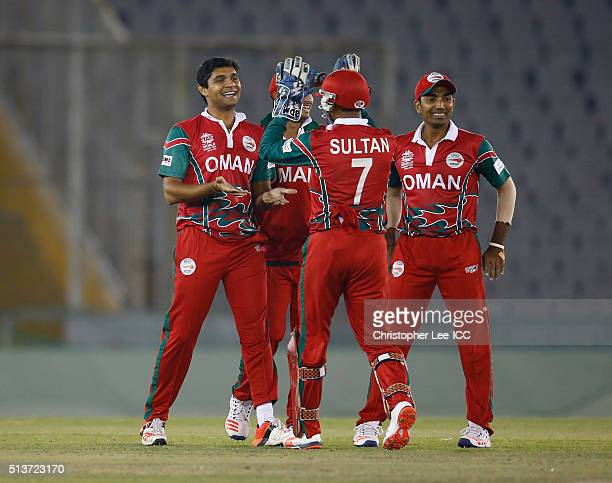 Ajay Lalcheta of Oman celebrates taking the wicket of Kyle Coetzer of Scotland with his team mates during the ICC Twenty20 World Cup Warm Up match...