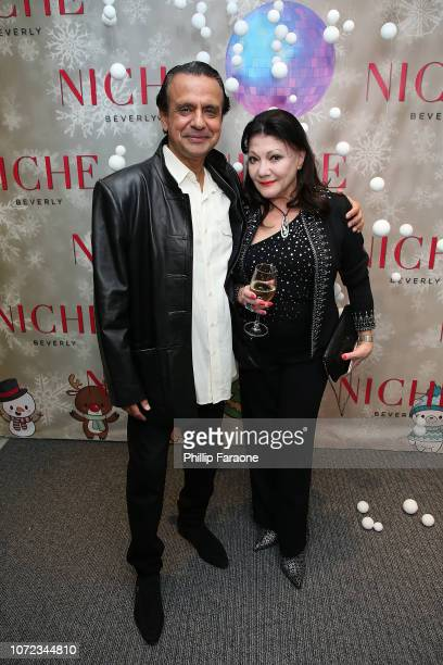 Ajay Mehta and Irina Maleeva attend the Niche Beverly 2018 Holiday Party at Niche Beverly on December 12 2018 in Los Angeles California