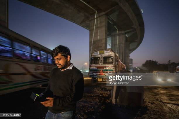 Ajay Mittal who is working for the NGO, Kolkata clean air, is measuring the air quality in one of Kolkata's most polluted area, the Garden Reach Dock...