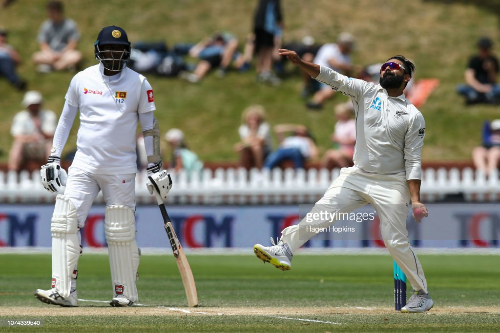 89f26783 Ajaz Patel of New Zealand bowls while Angelo Mathews of Sri Lanka ...