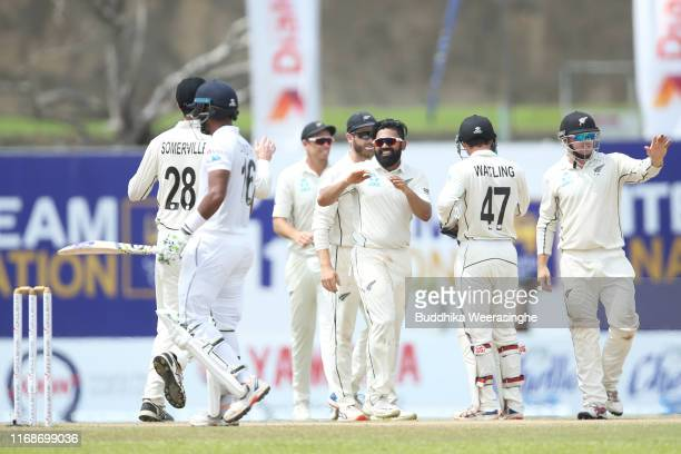 Ajaz Patel of New Zealand celebrates with his team mates after the dismissal of Kusal Mendis of Sri Lanka during day five of the First Test match...