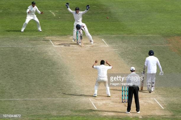 Ajaz Patel Ross Taylor and BJ Watling of New Zealand appeal unsuccessfully for the wicket of Kusal Mendis of Sri Lanka during day four of the First...