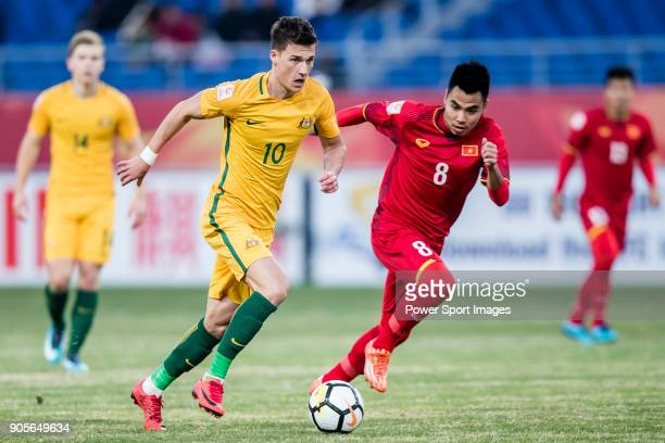 Ajdin Hrustic of Australia fights for the ball with Pham Duc Huy of Vietnam during the AFC U23 Championship China 2018 Group D match between Vietnam...
