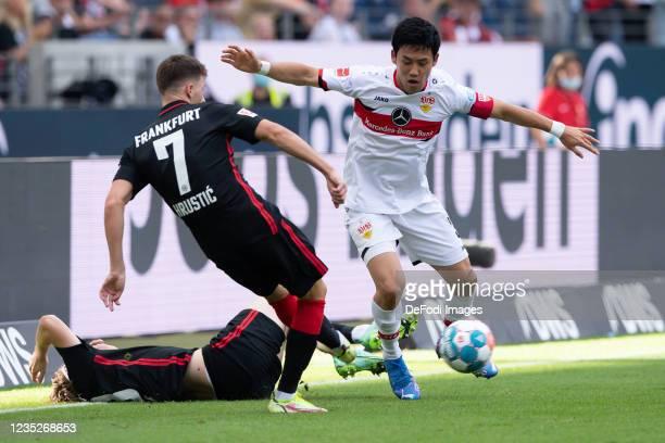 Ajdin Hrustic of Eintracht Frankfurt and Wataru Endo of VfB Stuttgart battle for the ball during the Bundesliga match between Eintracht Frankfurt and...