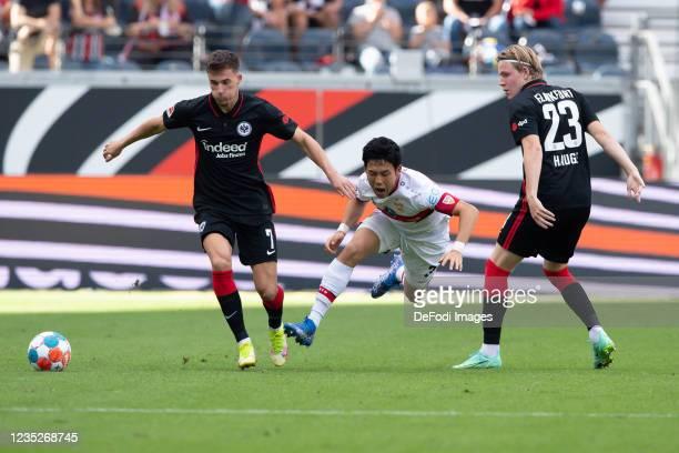 Ajdin Hrustic of Eintracht Frankfurt, Wataru Endo of VfB Stuttgart and Jens Hauge of Eintracht Frankfurt battle for the ball during the Bundesliga...
