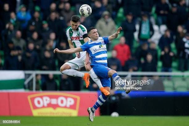 Ajdin Hrustic of FC Groningen Mustafa Saymak of PEC Zwolle during the Dutch Eredivisie match between FC Groningen v PEC Zwolle at the NoordLease...