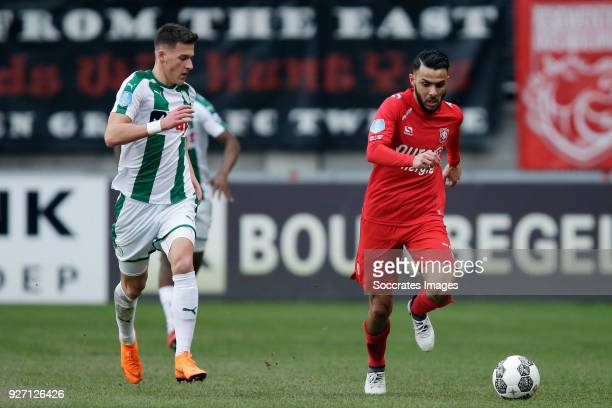 Ajdin Hrustic of FC Groningen Oussama Assaidi of FC Twente during the Dutch Eredivisie match between Fc Twente v FC Groningen at the De Grolsch Veste...