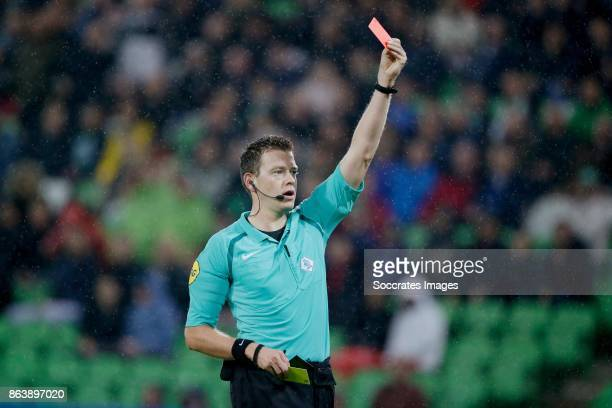 Ajdin Hrustic of FC Groningen receives a red card from referee Allard Lindhout during the Dutch Eredivisie match between FC Groningen v Willem II at...