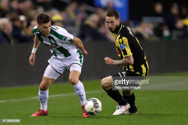 Ajdin Hrustic of FC Groningen Tim Matavz of Vitesse during the Dutch Eredivisie match between Vitesse v FC Groningen at the GelreDome on February 2...