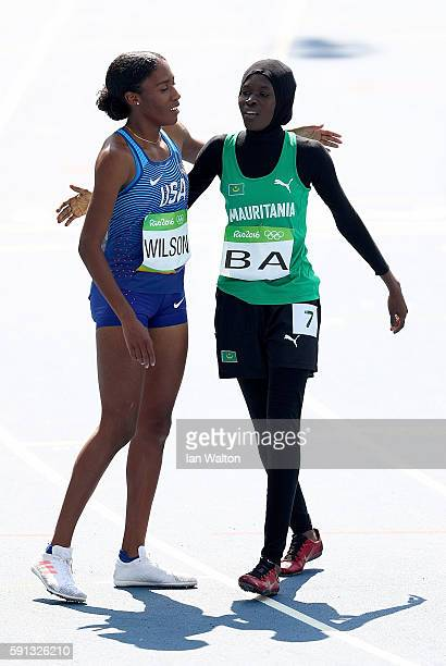 Ajee Wilson of the United States and Houleye Ba of Mauritania react during the Women's 800m Round 1 heats on Day 12 of the Rio 2016 Olympic Games at...