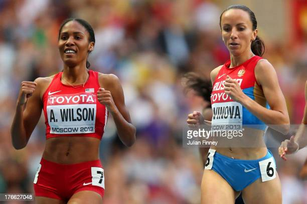 Ajee Wilson of the United States and Mariya Savinova of Russia compete in the Women's 800 metres semi finals during Day Seven of the 14th IAAF World...