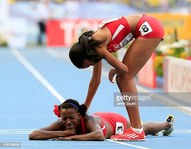 Ajee Wilson of the United States consoles Alysia Johnson Montano of the United States as she lies on the track after falling at the finish line in...