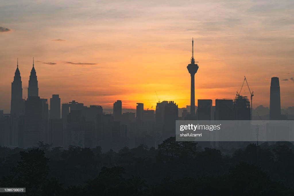 ajestic sunrise over downtown Kuala Lumpur, a capital of Malaysia. : Stock Photo