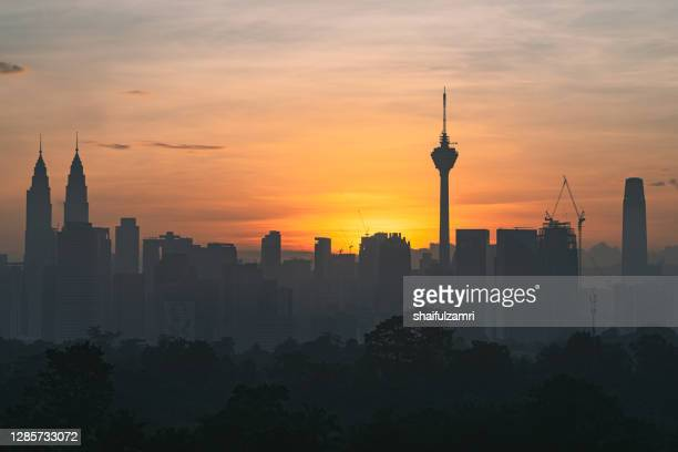 ajestic sunrise over downtown kuala lumpur, a capital of malaysia. - shaifulzamri stock pictures, royalty-free photos & images
