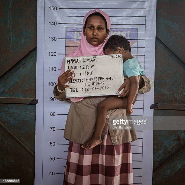 Ajidah a Rohingya migrant woman poses for identification purposes at a temporary shelter on May 18 2015 in Kuala Langsa Aceh province Indonesia...