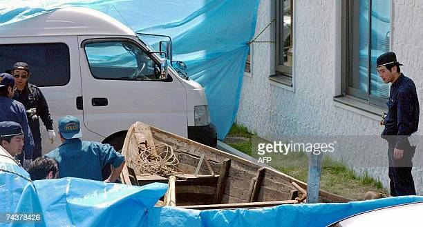 Japanese police inspect an eight-meter wooden boat at Ajigasawa Police Station in Aomori Prefecture, northern Japan, 02 June 2007, after it was...