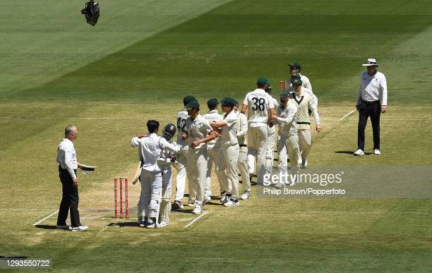 Ajinkya Rahane embraces Shubman Gill after India won the Second Test match between Australia and India at Melbourne Cricket Ground on December 29,...