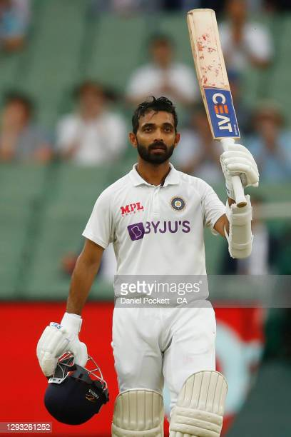 Ajinkya Rahane of India celebrates after reaching 100 runs during day two of the Second Test match between Australia and India at Melbourne Cricket...