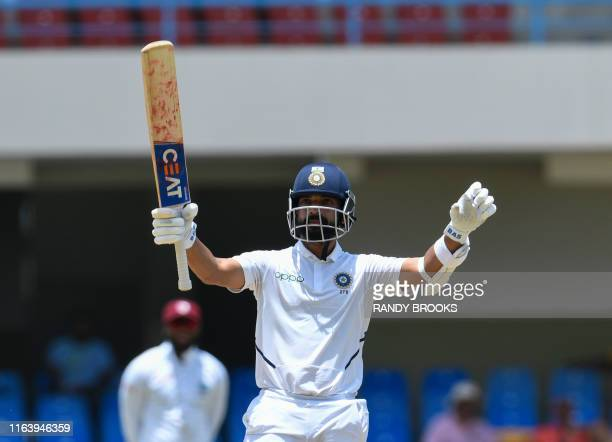 Ajinkya Rahane of India celebrates his century during day 4 of the 1st Test between West Indies and India at Vivian Richards Cricket Stadium in North...