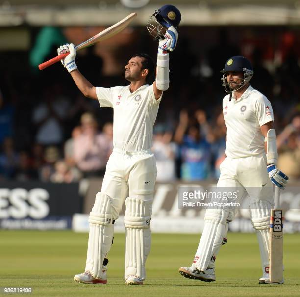 Ajinkya Rahane of India celebrates reaching his century during his innings of 103 with teammate Mohammed Shami during the 2nd Test match between...