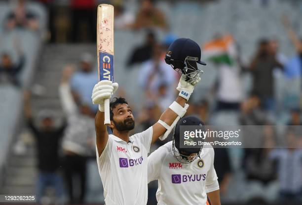 Ajinkya Rahane of India celebrates reaching his century with Ravindra Jadeja during day two of the Second Test match between Australia and India at...