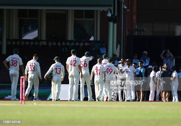 Ajinkya Rahane of India congratulates the Australian players after the match ended in a draw during day five of the 3rd Test match in the series...