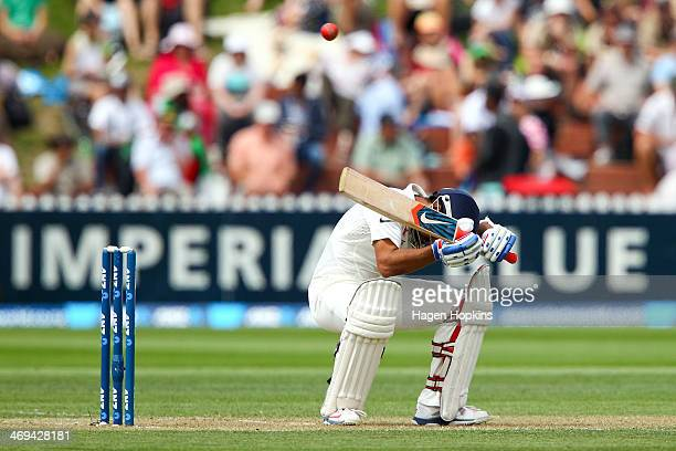 Ajinkya Rahane of India ducks under a bouncer during day two of the 2nd Test match between New Zealand and India on February 15 2014 in Wellington...