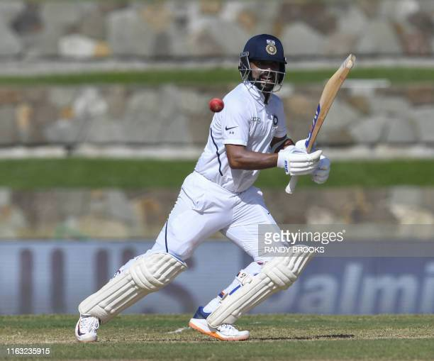 Ajinkya Rahane of India hits 4 during day 1 of the 1st Test between West Indies and India at Vivian Richards Cricket Stadium in North Sound, Antigua...