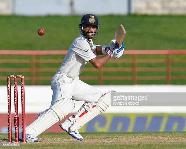 Ajinkya Rahane of India hits 4 during day 4 of the 3rd Test between West Indies and India at Darren Sammy National Cricket Stadium Gros Islet St...