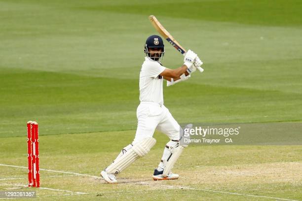 Ajinkya Rahane of India hits a four to bring up his century during day two of the Second Test match between Australia and India at Melbourne Cricket...