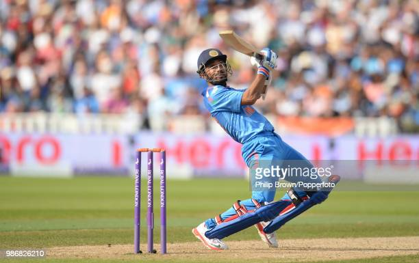 Ajinkya Rahane of India ramps the ball to the boundary during his innings of 106 in the 4th Royal London One Day International between England and...