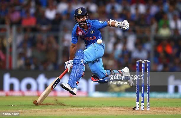 Ajinkya Rahane of India slides his bat to make his ground during the ICC World Twenty20 India 2016 Semi Final match between West Indies and India at...