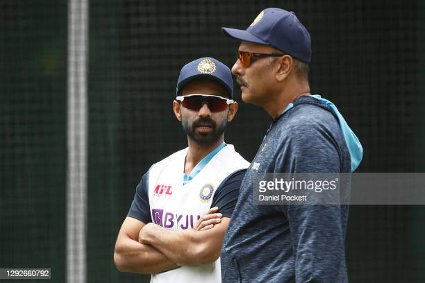 Ajinkya Rahane of India speaks with India head coach Ravi Shastri during an Indian Nets Session at the Melbourne Cricket Ground on December 23, 2020...
